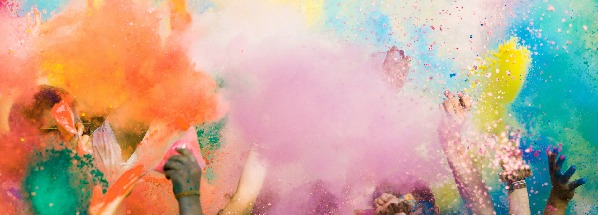 Diverse hands throwing paint bombs