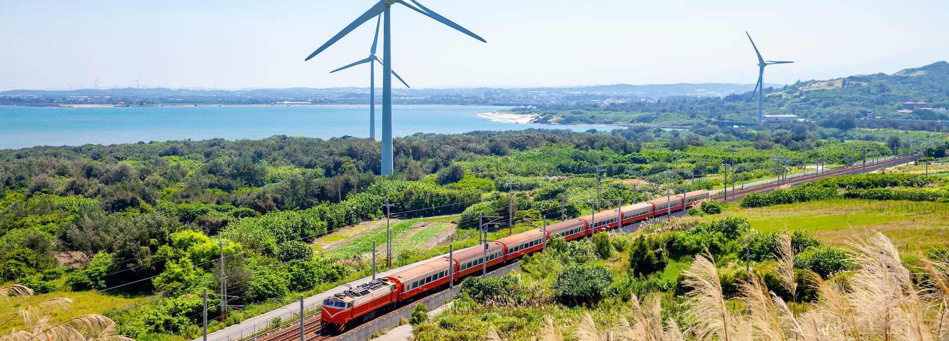 Train passing before wind turbines
