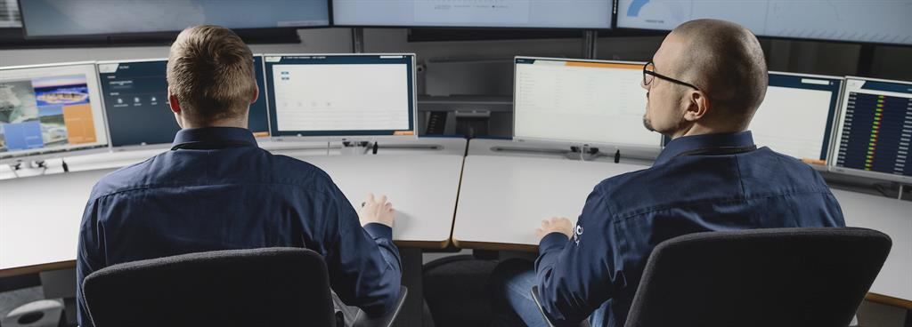 Two Wärtsilä specialists examine operational data provided virtually.
