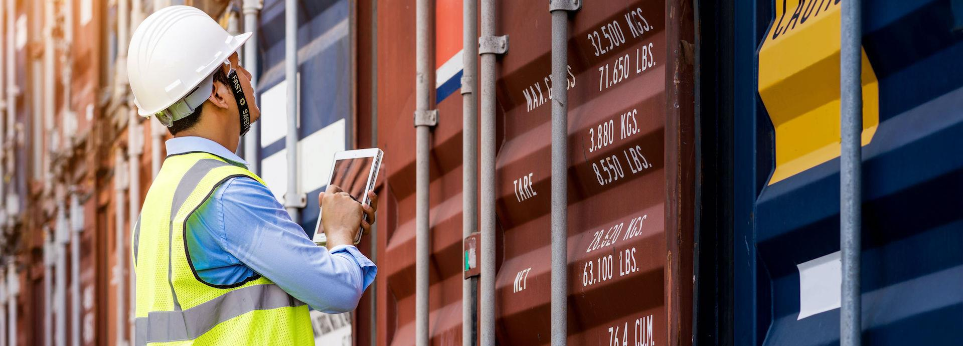 Workman tracking shipping containers